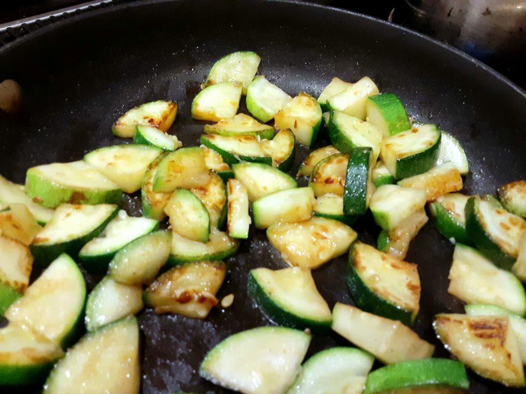 zucchini sauteeing in pan