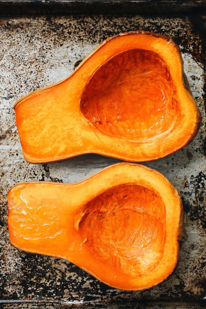 butternut squash roasted on a sheet pan with skin still on